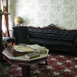 All the black upholstered furniture is original.