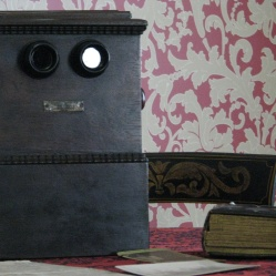 A stereoscope for viewing images in 3-D.